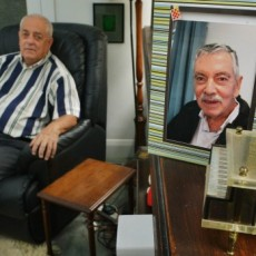 Tony Walsh (left) with a picture of his partner Paul Wenn, who died last year. Photo: Joe Armao