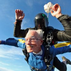 PIC BY CATERS NEWS - (PICTURED:Glenn during tandem skydive) - A daring grandpa celebrated his 100th birthday by jumping out of a plane at 13000ft. Glenn Quillin decided to mark the special occasion with a skydive and asked his grandson, Michael Welch, to set up the tandem jump for January 17. The stunt was kept secret from the rest of the family until the day before, when they were handed an invitation to join Glenn at Skydive San Diego in California, USA. Michael and his sister Lisa Rhee also braved the jump, which included a minute free-fall, while the rest of Glenns proud family watched from the landing field. SEE CATERS COPY