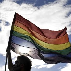 A reveler flutters a rainbow flag during the Gay Pride Parade in Bogota, Colombia on June 28, 2015. AFP PHOTO / GUILLERMO LEGARIA        (Photo credit should read GUILLERMO LEGARIA/AFP/Getty Images)