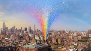 New York City landscape with rainbow confetti erupting from the site of the Stonewall In 50 years on to commemorate the Stonewall riots 50th anniversary