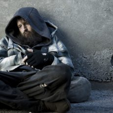 USA, Utah, Salt Lake City, Homeless man sitting on sidewalk