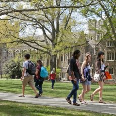 spring scenes on West Campus   students on academic quad with Perkins Library in background